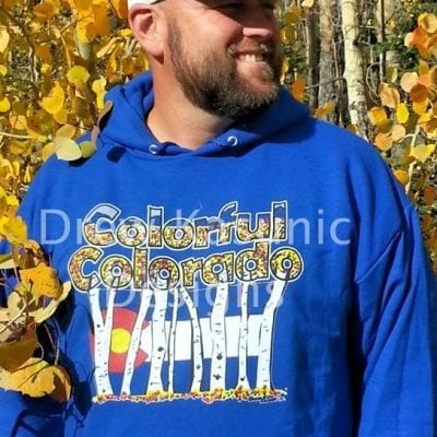 Colorful Colorado original art front worn by Drew on blue Hoodie